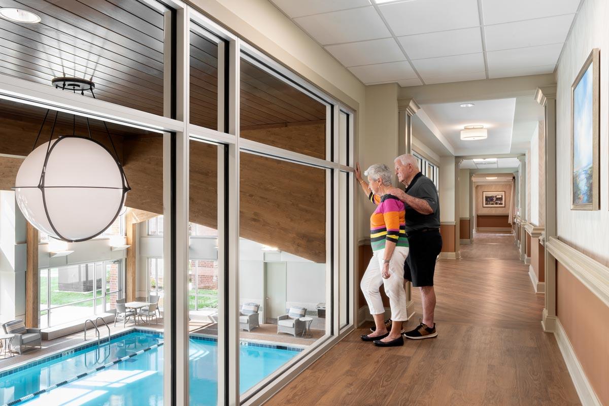 Wyndamere Senior Living Corridor overlooking pool